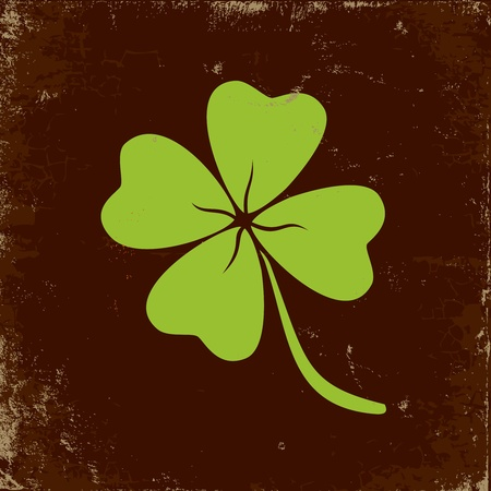 four: Clover with four leaves in brown background