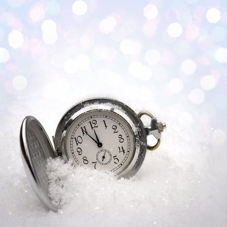 Watch lying in the snow before the new year Stock Photo - 15465583