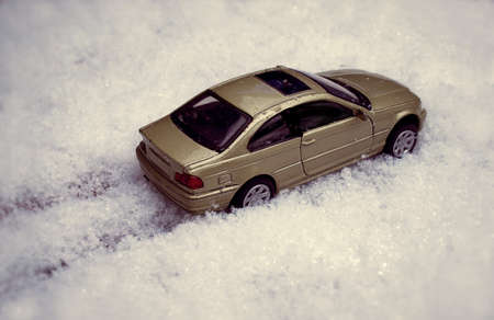 Toy Car riding through snow photo