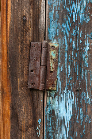 Old rusty door hinge photo