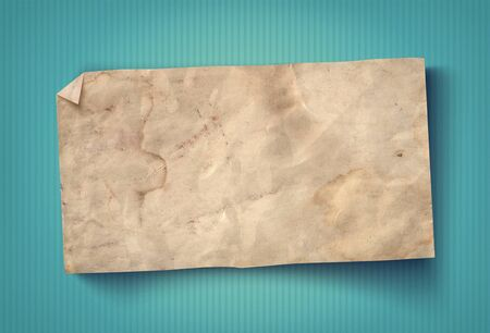 Vintage paper on turquoise background. White paper texture on old background