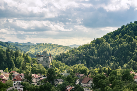 Countryside overlook view of houses and castle over the hills in the summer Stok Fotoğraf
