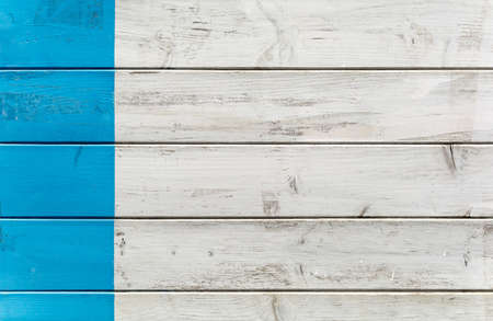 Blue and white old painted wood wall - Aged texture or background with sea blue color strip - layout concept with mediterranean typical color