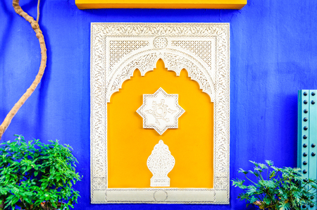 Colorful window in Jardin Majorelle, former residence of fashion designer Yves Saint Laurent in Marrakesh Morocco. Yellow window frames of the blue house of Yves Saint-Laurent. Museum of Islamic art.