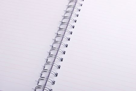Blank spiral notebook ready for writing photo