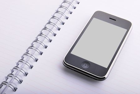 mobile phone and spirals with a white agenda Stock Photo - 4597739