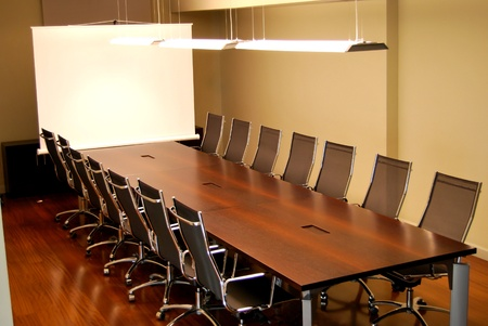 A business meeting room with chairs and table
