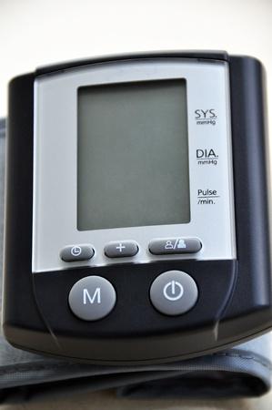 A modern blood pressure monitor and cuff photo