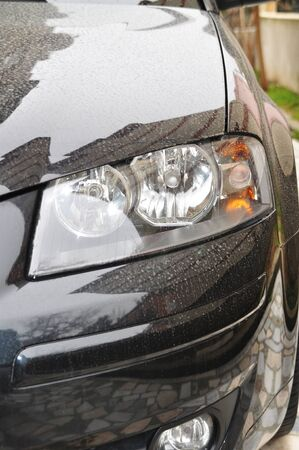 Close-up of a new modern car head  photo