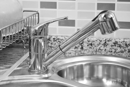 stainless steel kitchen: Close-up of a sink in a modern kitchen