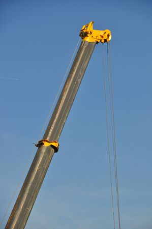 Closeup of jib crane against blue sky photo