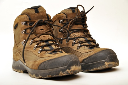 muddy clothes: Trekking shoes and a white background