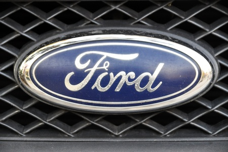 Close-up Ford logo. Chrome metal