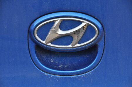 Close-up Hyundai logo. Chrome metal