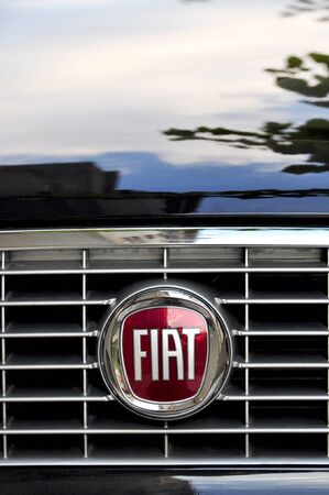 Close-up Fiat logo. Chrome metal
