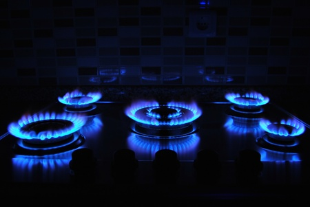 Blue flame of gas over black background photo