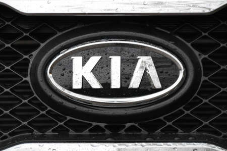 Kia logo on a wet black car Stock Photo - 12280313