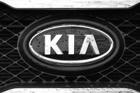 Kia logo on a wet black car Stock Photo - 12280313