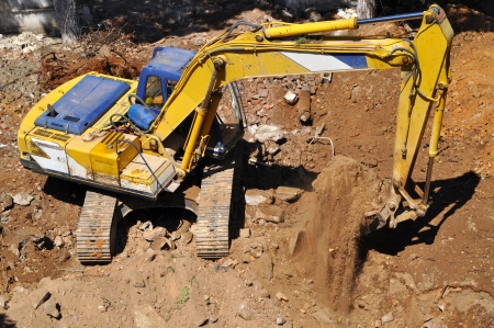 Continuing the work of a bulldozer on site excavation Stock Photo