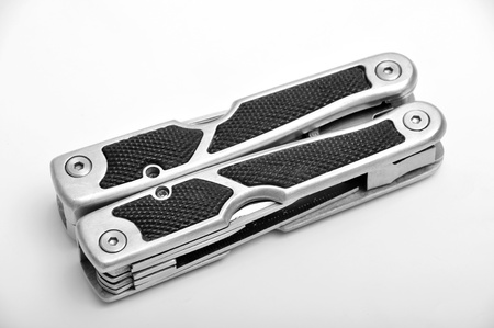 Folded multitool isolated on white background photo