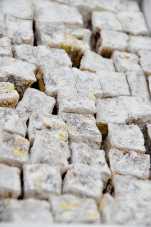 Turkish delight with nuts sprinkled with powdered sugar and coconut photo