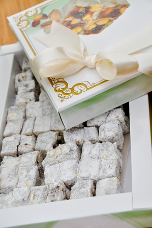 Turkish delight with nuts sprinkled with powdered sugar and coconut Stock Photo - 13791157
