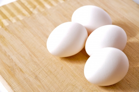 White eggs in a kitchen on board Stock Photo - 13791418