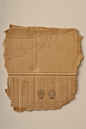 Torn cardboard and paper recycling sign photo