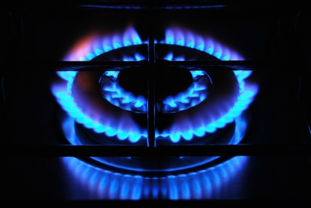 Blue flame of gas over black background Stock Photo - 18333331