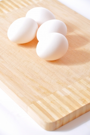 White eggs in a kitchen on board photo