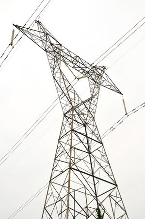 tension: High voltage electricity cables datail over a clean sky Stock Photo