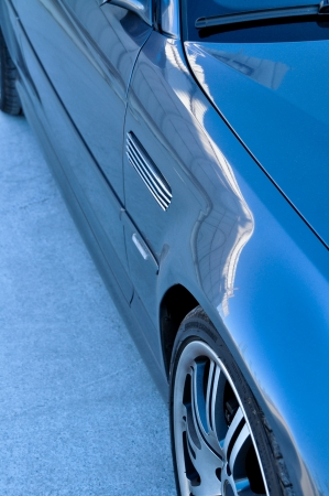 bmw: The details of the blue car and the front wheel