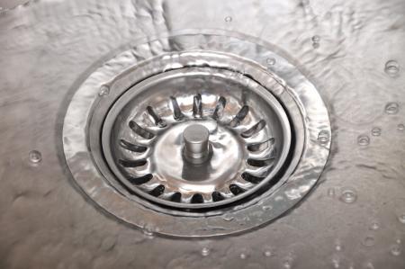 Background with splashing water in kitchen sink Stock Photo - 18654815
