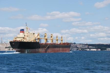 arrive: Cargo boat arrive Bosphorus Istanbul Stock Photo