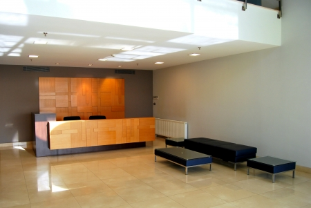 hotel reception:  A business center, an empty lobby and reception