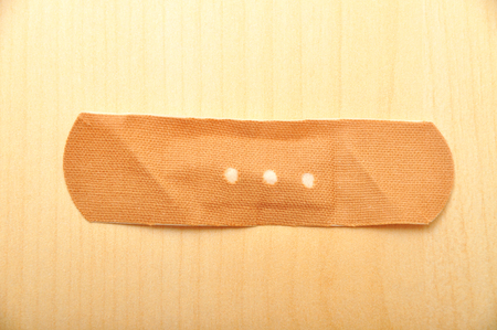 The used band-aid, on the wooden floor photo