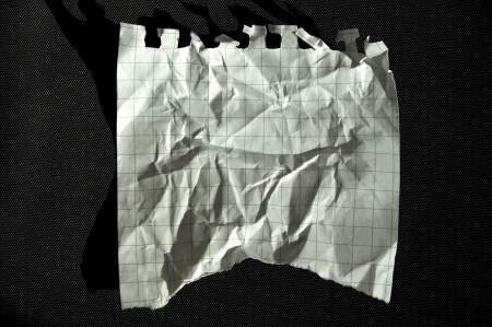 Checkered line, clean white torn paper photo