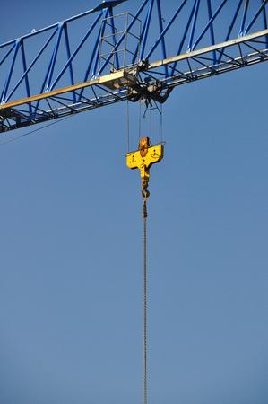 jib: Closeup of yellow jib crane against blue sky