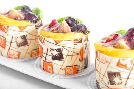 Yummy cake with fruit particles on
