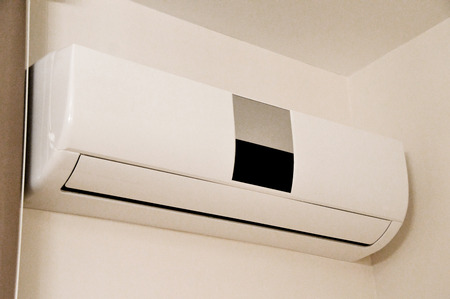 conditioned: Air conditioner indoor unit mounted on home wall