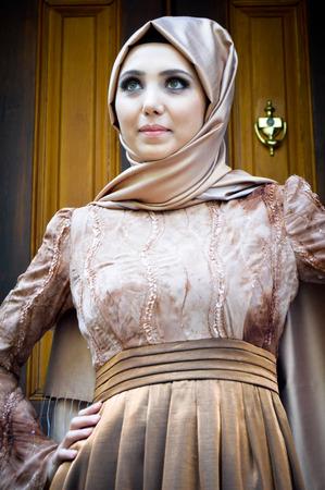 stylishly: Beautiful muslim young woman very stylishly dressed Stock Photo