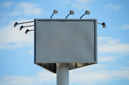 outdoor advertising: Outdoor advertising billboard on blue sky Stock Photo