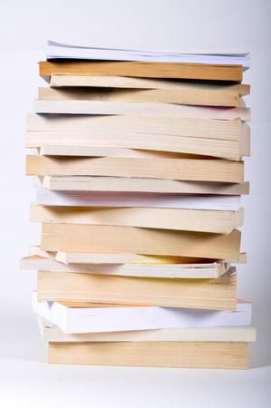 Pile of books on white background photo