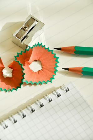 swarf: Small pencils and pencil sharpener on a white background