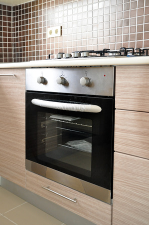 Built-in oven and hob in a modern kitchen