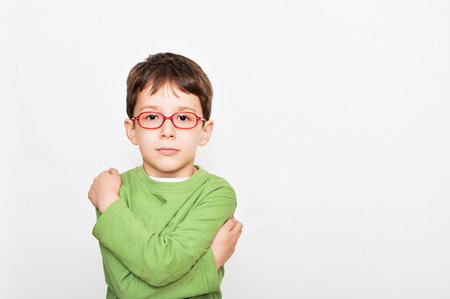 bespectacled: 6-year-old red bespectacled boys facial expression Stock Photo