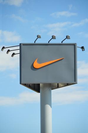 outdoor advertising: Outdoor advertising nike billboard on blue sky