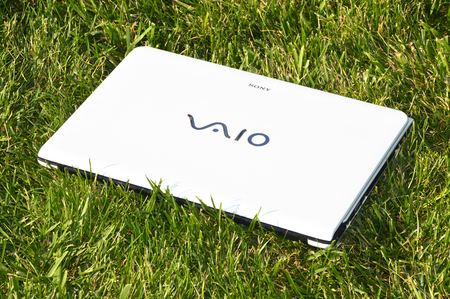 White Sony Vaio laptop on the green grass