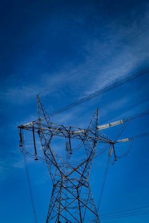 over voltage: High voltage electricity cables datail over a clean blue sky