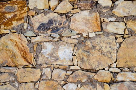 yellow stone: Yellow stone wall texture can be background